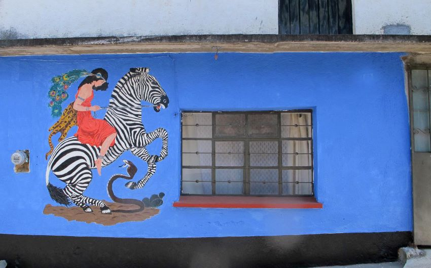 The Zebra Mural was designed by Władysław T. Benda and painted on the wall by Hermes and Diego.