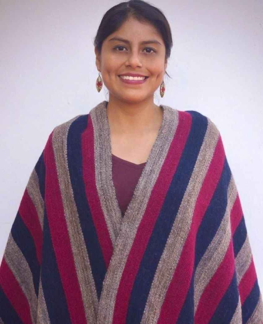 Woman in traditional striped rebozo.