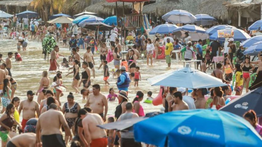 Tourists largely ignored warnings that Mexico could see a third wave of the coronavirus, with most eschewing masks and other Covid safety measures.