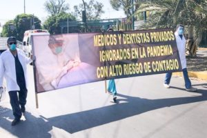 Private-sector doctors and dentists in Mexico City last week protesting the fact that they have yet to be vaccinated.