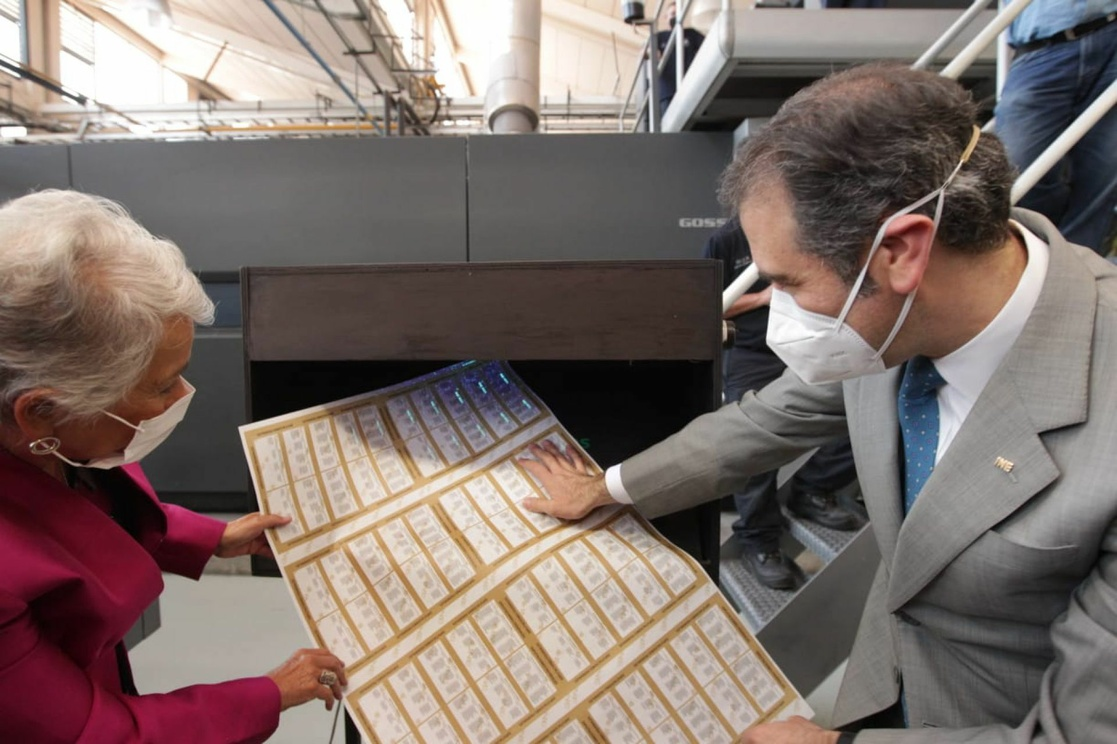 National Electoral Institute president Lorenzo Córdova and Interior Minister Olga Sánchez look over ballots for the upcoming federal deputy elections in June.