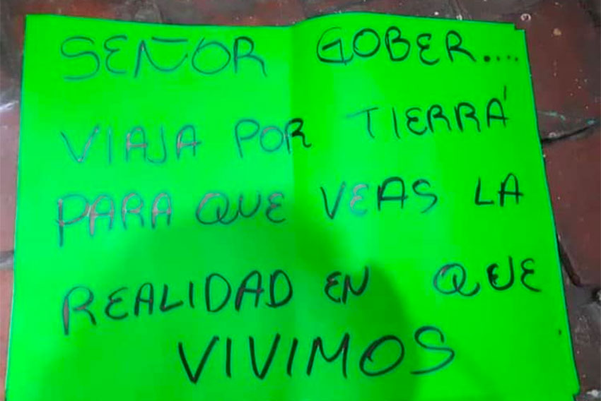 a poster that greeted Aureoles' arrival in Aguililla this week.