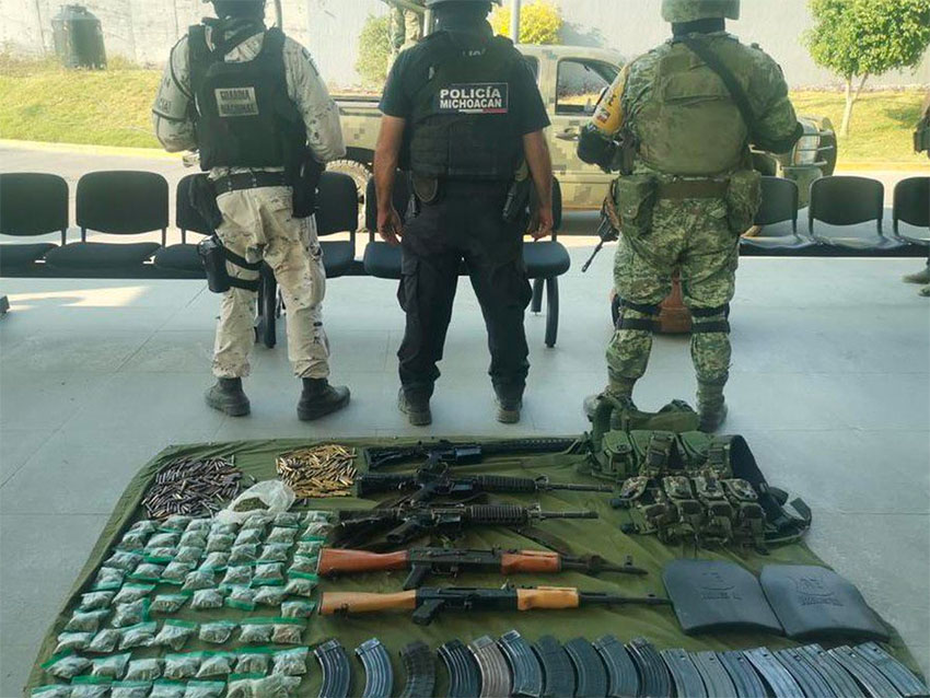 Arms and marijuana were seized after the brigade was attacked.