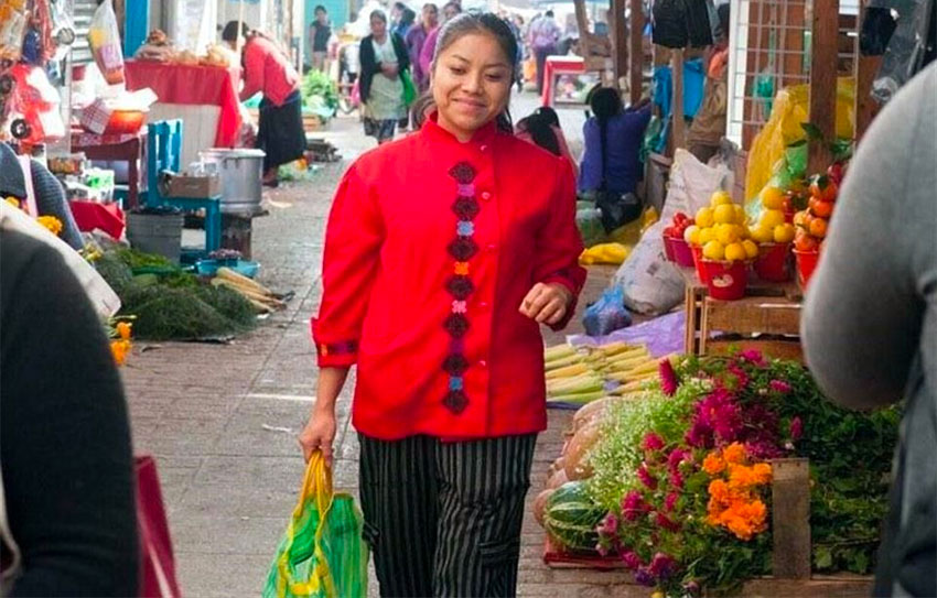 Chef Ruiz shops at the market for her restaurant in San Cristóbal.