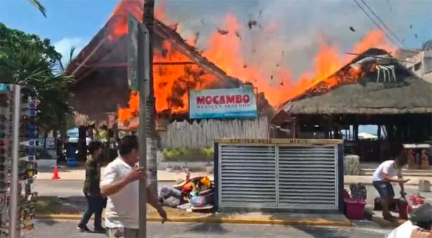 Mocambo restaurant and adjacent businesses burn during Monday's fire.