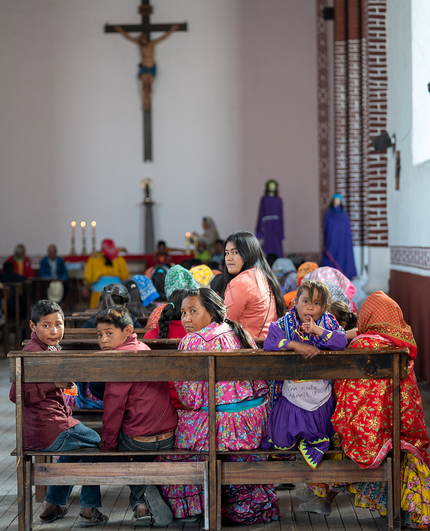 Women and girls gather in church during the celebrations to say prayers and leave carrying statues of Jesus and Mary.