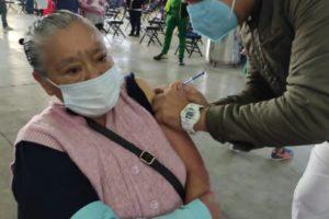 A senior citizen receives a Covid-19 vaccination in Mexico City.