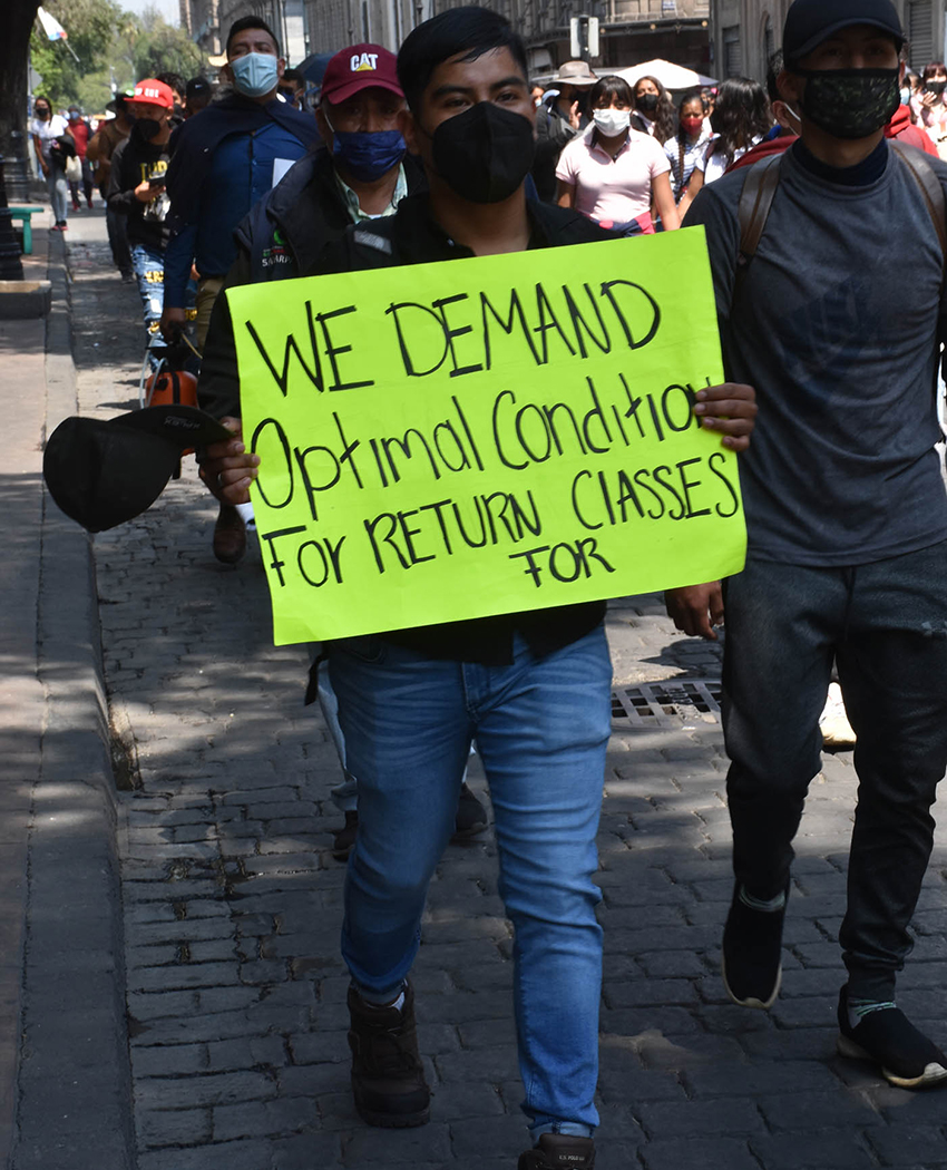 Student in Mexico City protesting government proposal to reopen schools nationwide in June