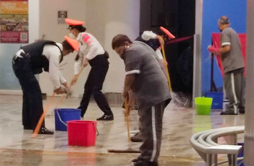 Mopping up wet floors at Benito Juárez International Airport.