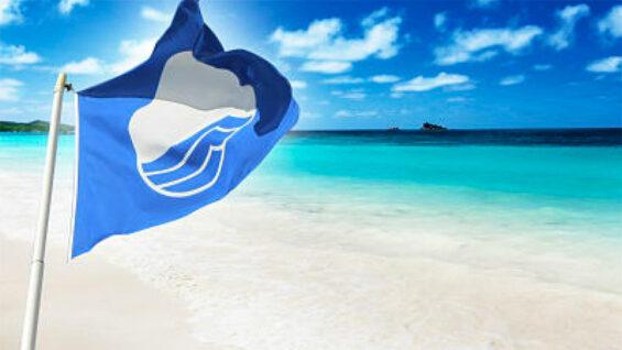 The blue flag flies on a Mexican beach.