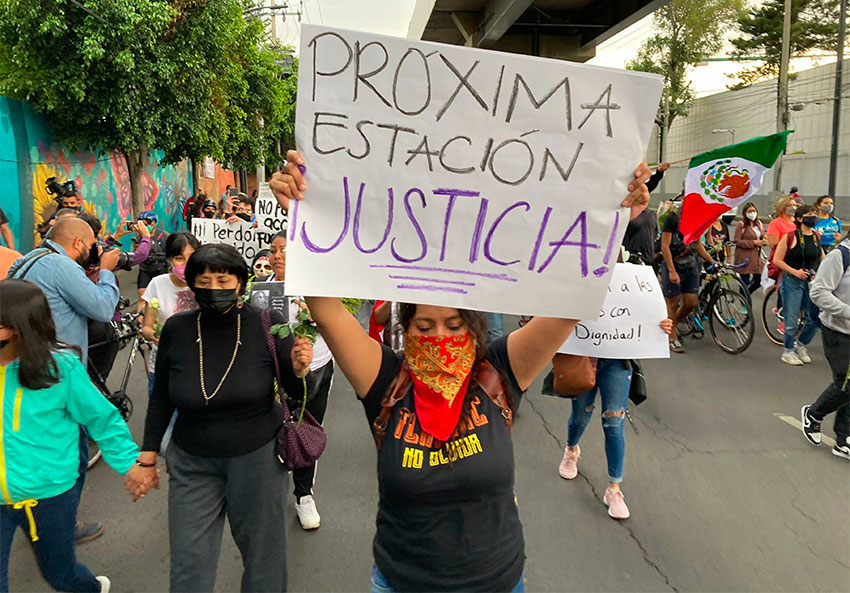 'Next station, justice,' reads the sign of a marcher during a protest Friday