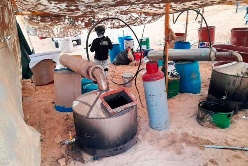 A National Guardsmen stands watch at a meth lab found in Sonora.