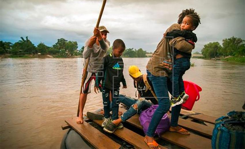 Migrants cross the Suchiate River into Mexico.