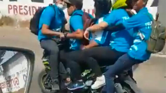 riders on scooter