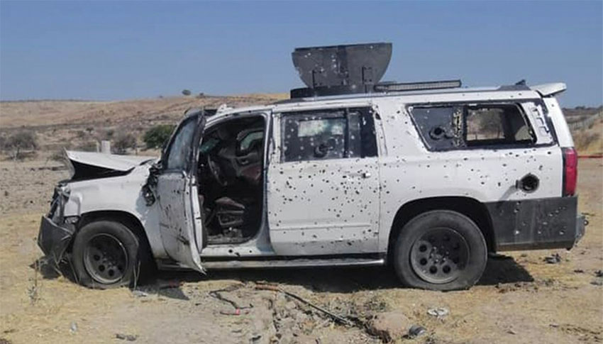 A bullet-riddled vehicle in Teocaltiche.
