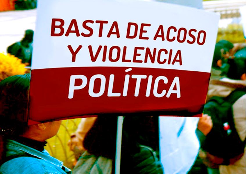 Woman holds sign calling for an end to assaults and political violence in Hidalgo.