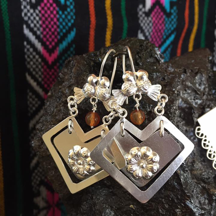 Earrings based on the traditional indigenous clothing the quexquemitl
