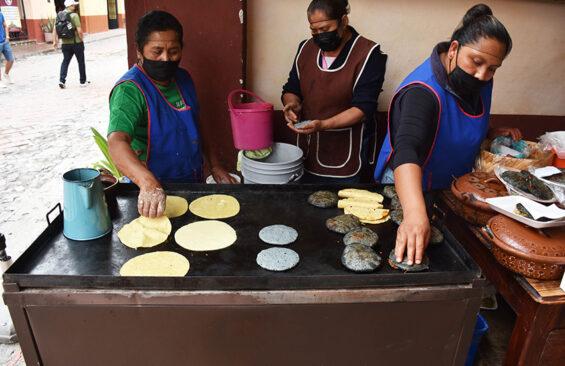 Woman make gorditas in Bernal's historic center.