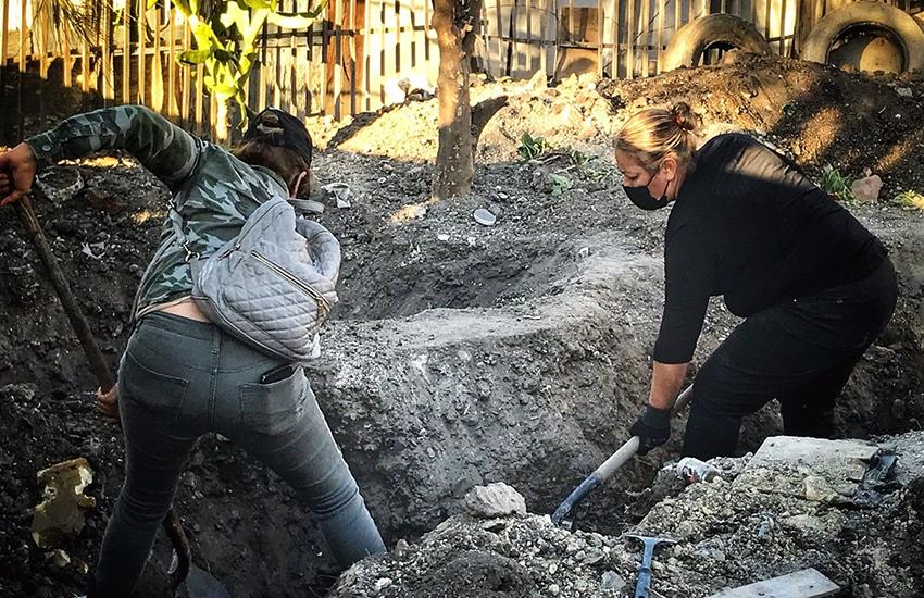 Tijuana family digs up clandestine grave