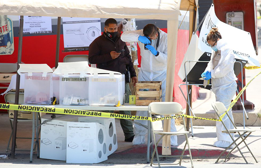 Forensic experts examine a polling station in Tijuana