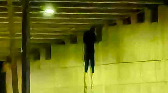 One of two bodies left hanging beneath an overpass Wednesday morning.