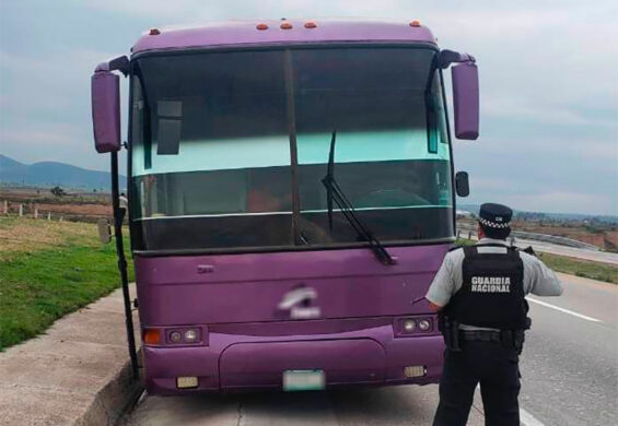 A National Guardsman in front of the stolen bus Monday in Tlaxcala.