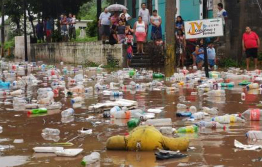 Garbage is swept away by floodwaters in Juchitán.
