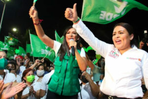 Merari, right, during her successful campaign for mayor after she took over for her late husband.