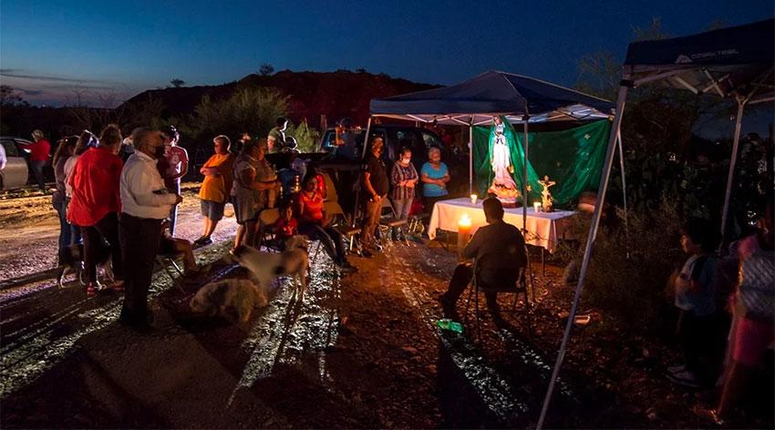 Miners' families conduct a vigil