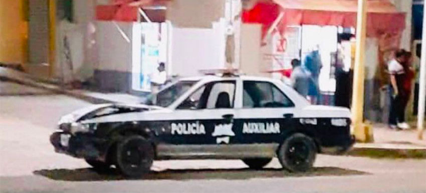 The patrol car in which the police were traveling when they struck a building.