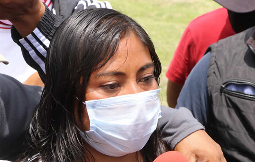 Magdalena Xalamihua speaks to reporters.