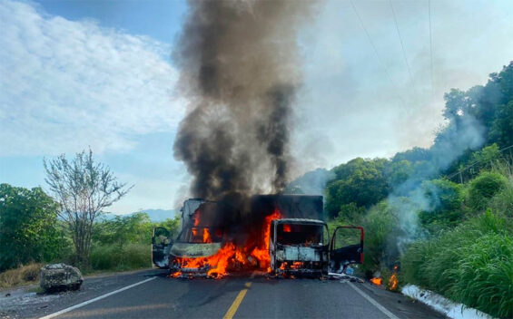 Trucks burn on the Uruapan-Cuatro Caminos highway.