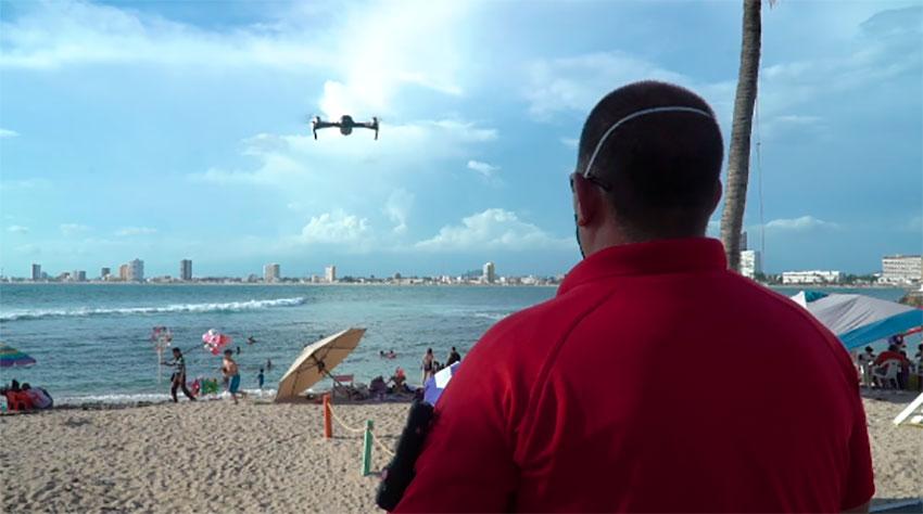 A drone flies over a beach in Mazatlán.