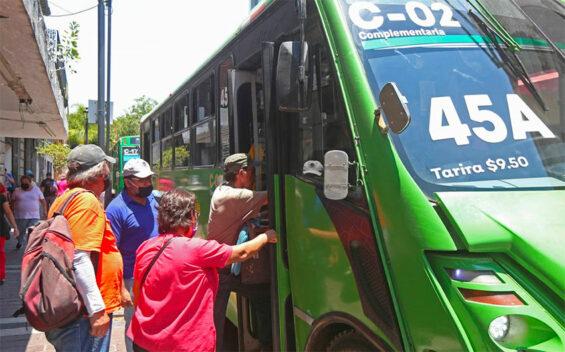 Riders board a public transit bus in Guadalajara.
