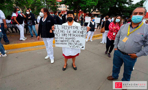 Healthcare workers protest outside a Oaxaca hospital on Tuesday.