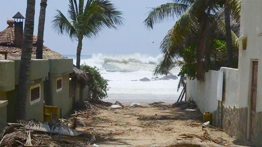 Surf pounds a beach in Oaxaca.