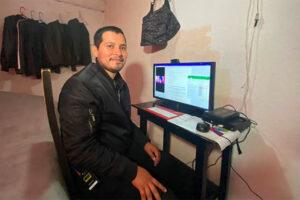 Samuel Olvera sits at his computer at his home in Naucalpan.
