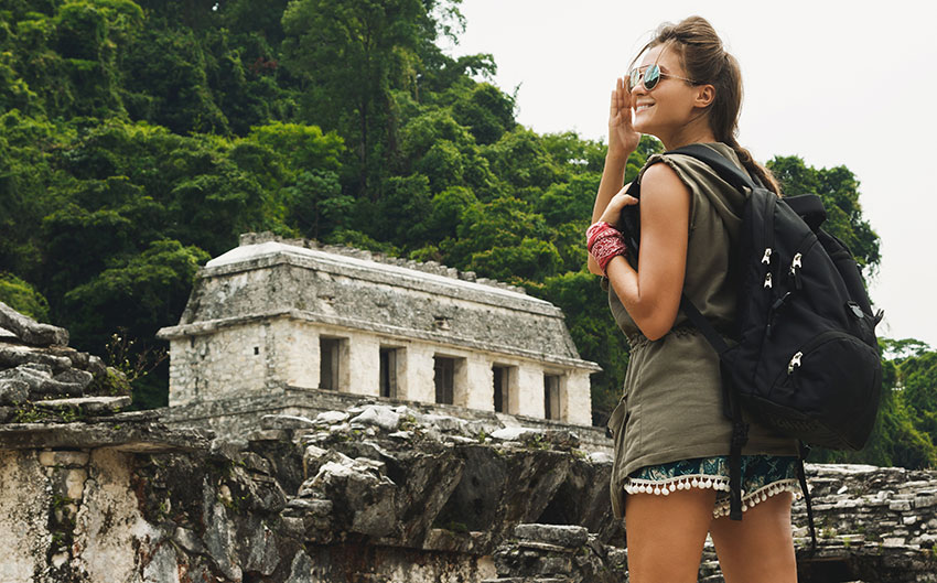 A visitor at a Mayan archaeological site.