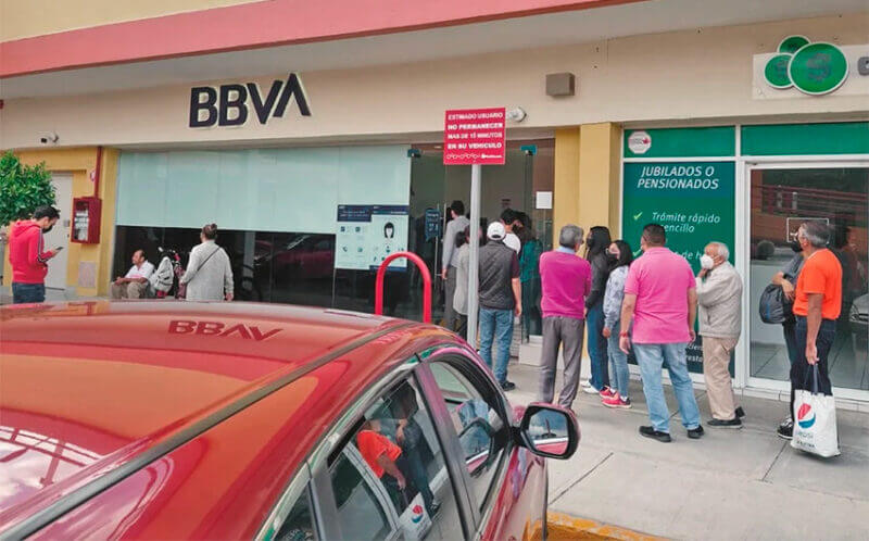 A lineup forms at an ATM Sunday